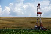 picture of  rig  - Color shot of a shale gas drilling rig on a field - JPG