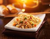 image of chinese restaurant  - chinese vegetable fried rice on plate with orange glow - JPG