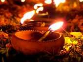 image of diwali  - Traditional Diwali lamps lit in a garden on the occassion of Diwali festival in India - JPG