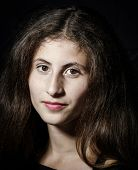 stock photo of mona lisa  - Cute young armenian girl posing in studio like Mona Lisa - JPG