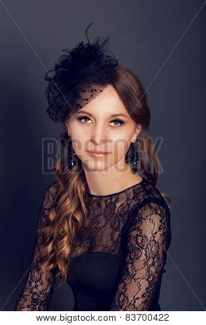Elegant Young Woman In Black Lace Dress And Veil Hat With Long Curly Hair