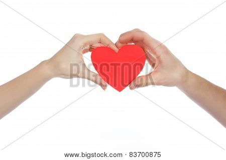 Couple in love holding a red paper heart in their hands isolated on white Background