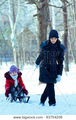 Girls With Sledge Rest At Winter Snow