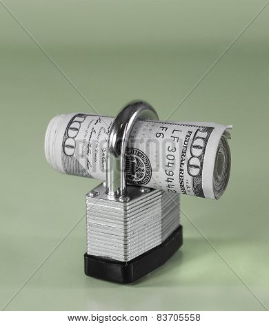 Roll of $100 Bills in Padlock (green background)