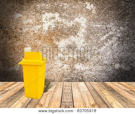 Yellow Garbage On Wooden Floor And Grunge Background