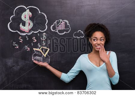 Smiling afro-american woman with dollar signs and purse on chalkboard