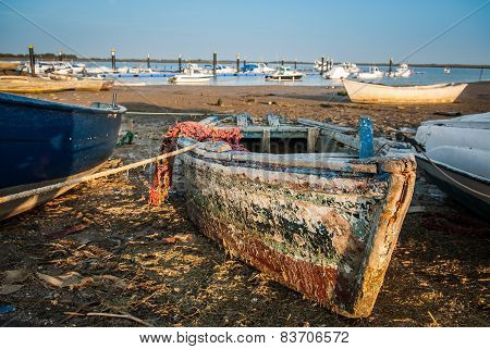 Abandoned fishing boat in marina