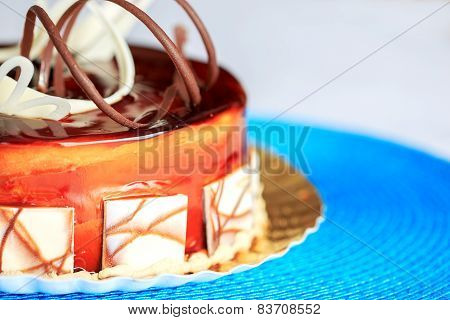Delicious Round Cake On Blue Tablecloth