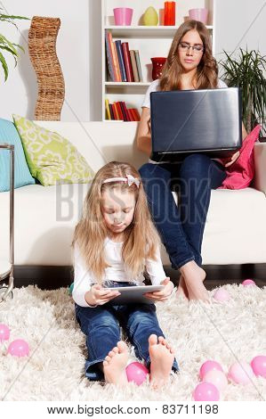 Mother Working While Child Is Playing