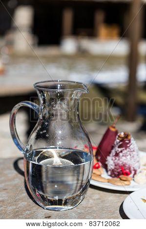 Jug Full Of Water And Defocused Background