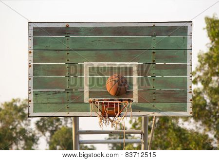 Shoot The Ball Of Basketball Into The Basket