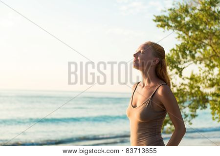 Woman watching sunset