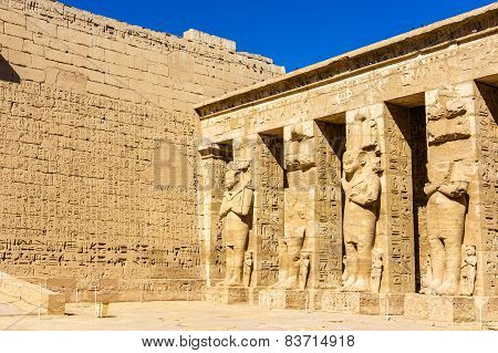 Ancient Egyptian Statues In The Mortuary Temple Of Ramses Iii