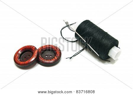 Spool Of Black Thread And Buttons