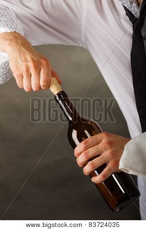 Man Opening Bottle Of Wine