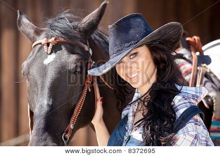Cute Cowgirl On Ranch