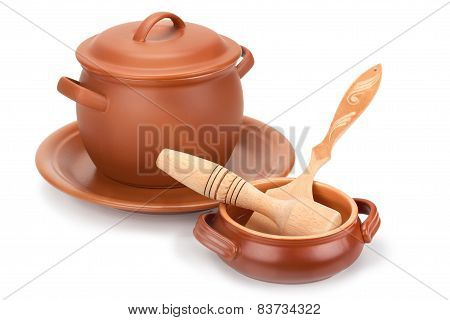 Clay Pots, Wooden Utensils And A Plate Of