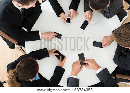 Businesspeople Using Cell Phone
