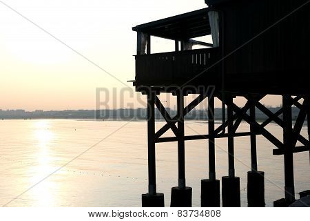 Large Wooden Stilt House On The Seashore