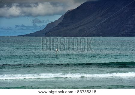 Surfing On Famara Beach, Lanzarote, Canary Islands, Spain
