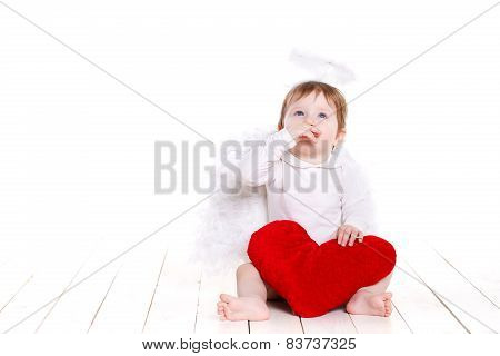 Angel child, a little girl with white wings and red heart in her hands.