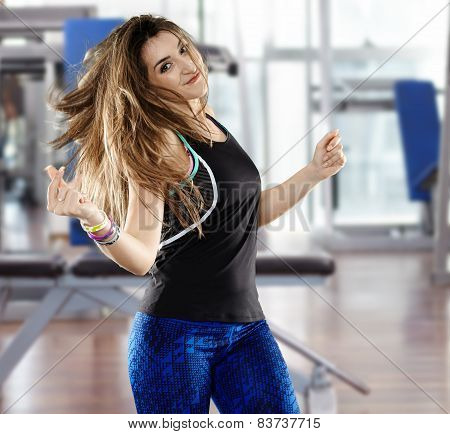 Woman Doing Aerobics At The Gym
