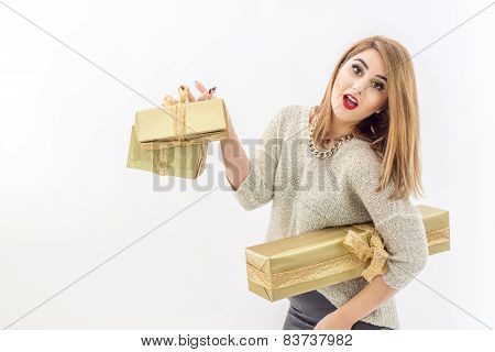 Fashion Woman Posing With Beautiful Gifts In Gold And Silver Packaging For Christmas Holiday, Isolat
