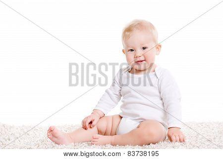 Portrait of a little boy on a white background.