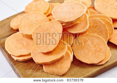 Chopped Sweet Potatoes On Wooden Board