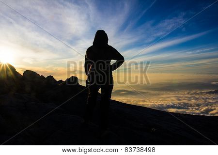 Woman Hiker On Top Of Mountain For Sunrise Or Sunset