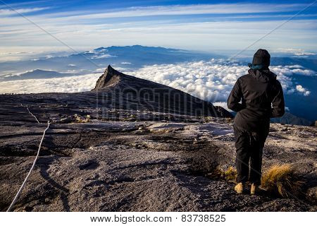 Woman Hiker On Top Of Mountain