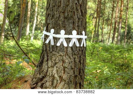 Paper Men Holding Hands Around A Tree