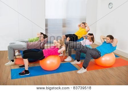 Group Of People Exercising On Pilate Ball