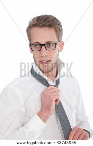 Close Up Handsome Young Man Tying A Neck Tie