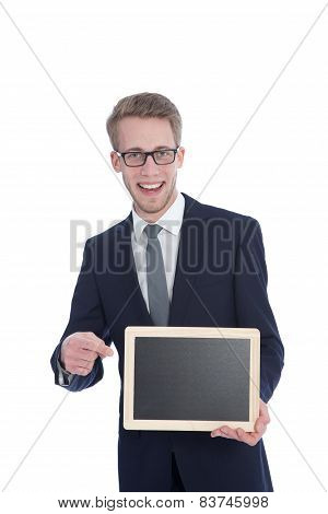 Handsome Young Businessman Holding An Empty White Small Board