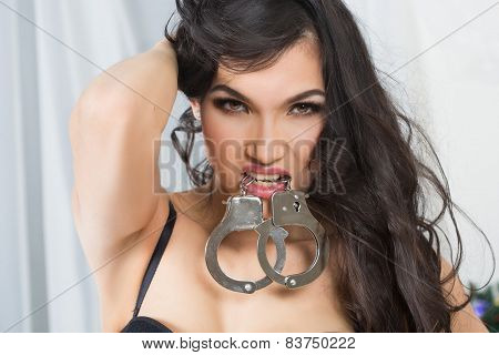 Woman in underwear, bite handcuffs, bdsm, sex toy