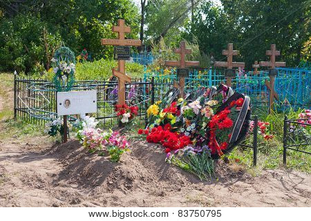 Graves, Flowers, Wreaths And Crosses In Cemetery