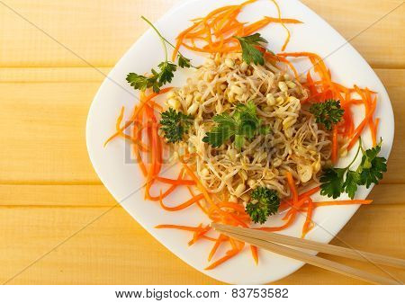 soy sprouts salad with carrots and parsley
