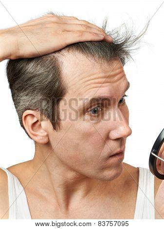 Man With Mirror Looking At His Hair