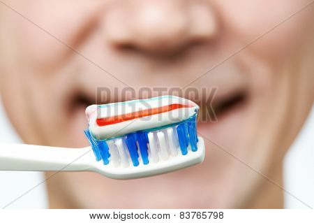 Man Brushing Teeth Toothbrush With Toothpaste
