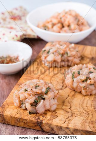 Raw Chicken Cutlets With Herbs On Olive Wood Background