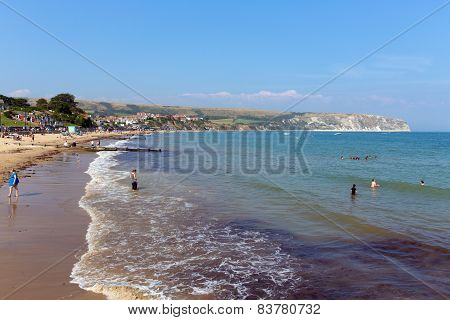 Sunshine and warm weather brought bathers to Swanage beach Dorset coast