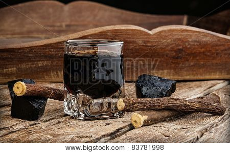 Licorice Liqueur With Pure Blocks And Roots.