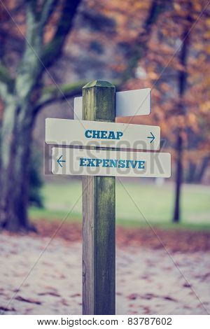 Rural Signboard With Two Signs Saying - Cheap - Expensive