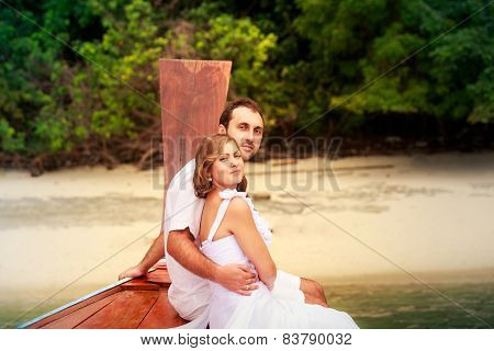 Groom Embrace Bride Sitting On Longtail Boat