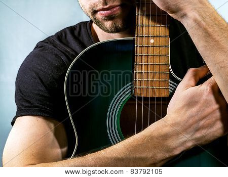 Guitarist Holding An Acoustic Guitar