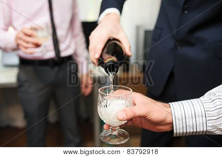 glass with Champagne during the wedding say