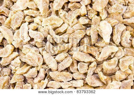 Sugar coated dried Indian Gooseberry background kept in sunlight