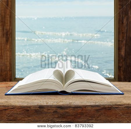 imagination concept book heart shape page open window sea