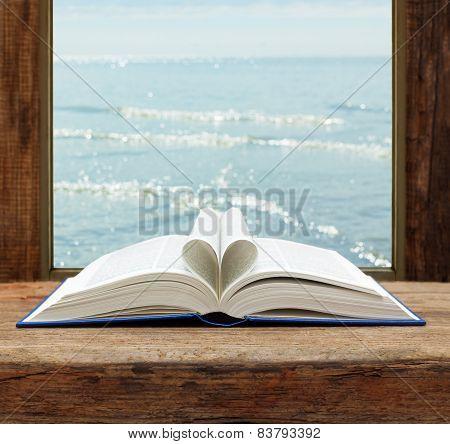 imagination concept book heart shape page open window sea